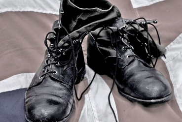FirstLight Boots on top of a Union Jack flag