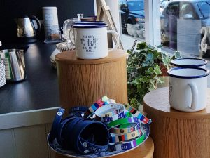 Mugs and merchandise for sale in our Hawick cafe