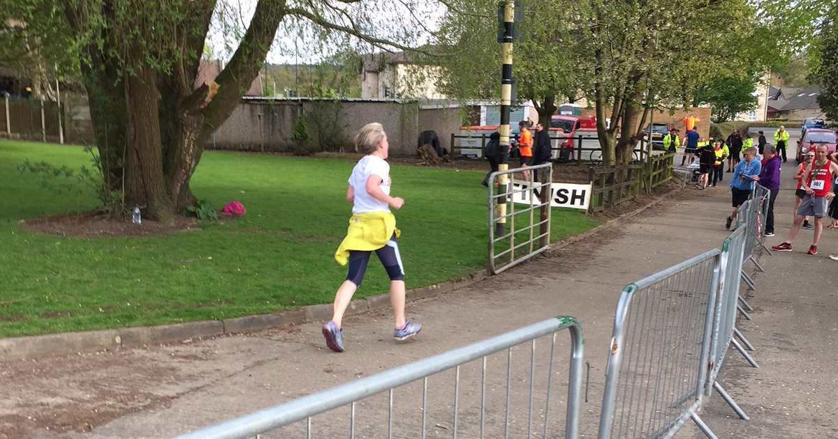 FirstLight Trust Lancaster charity worker runs towards the finish line