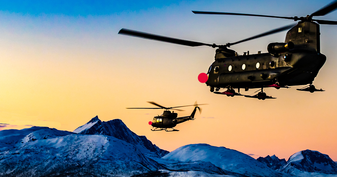 Christmas opening hours - Chinook helicopters with red noses over mountains