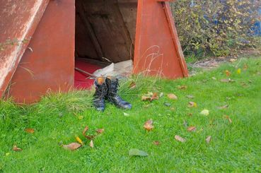 FirstLight Boots outside shelter