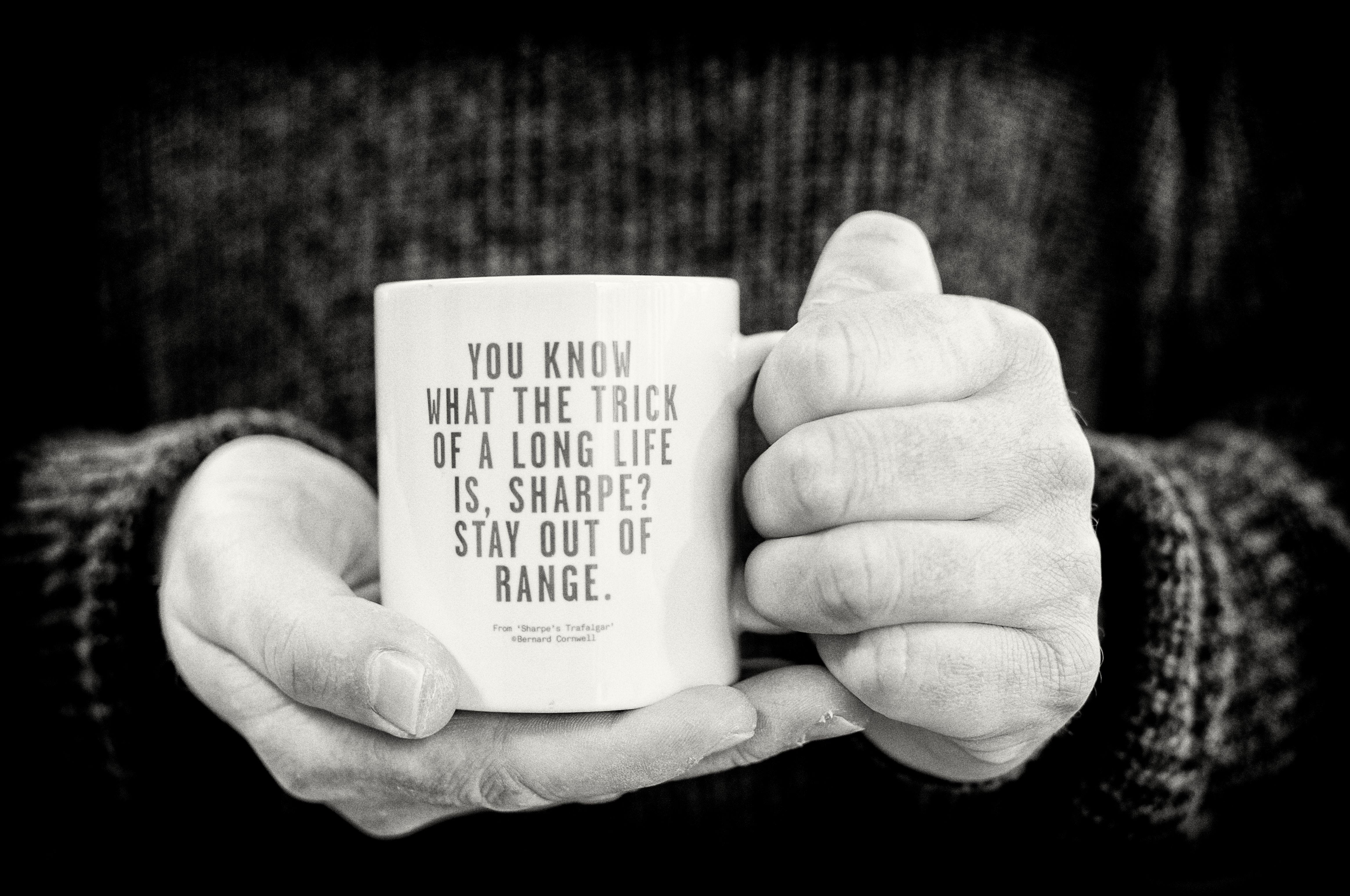 Black and white image of holding a mug - copyright Rob Leyland