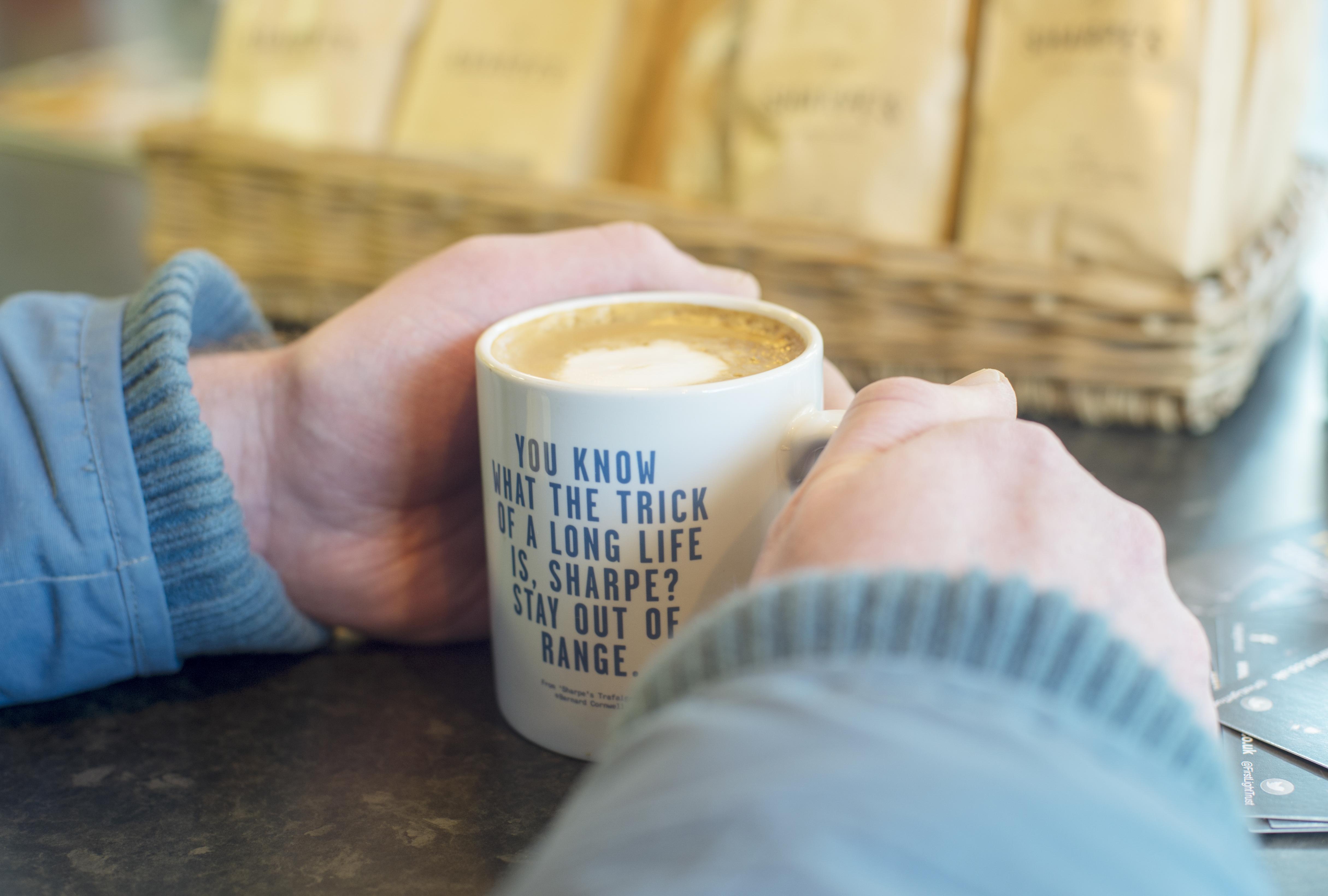 FirstLight Trust veteran holding a mug