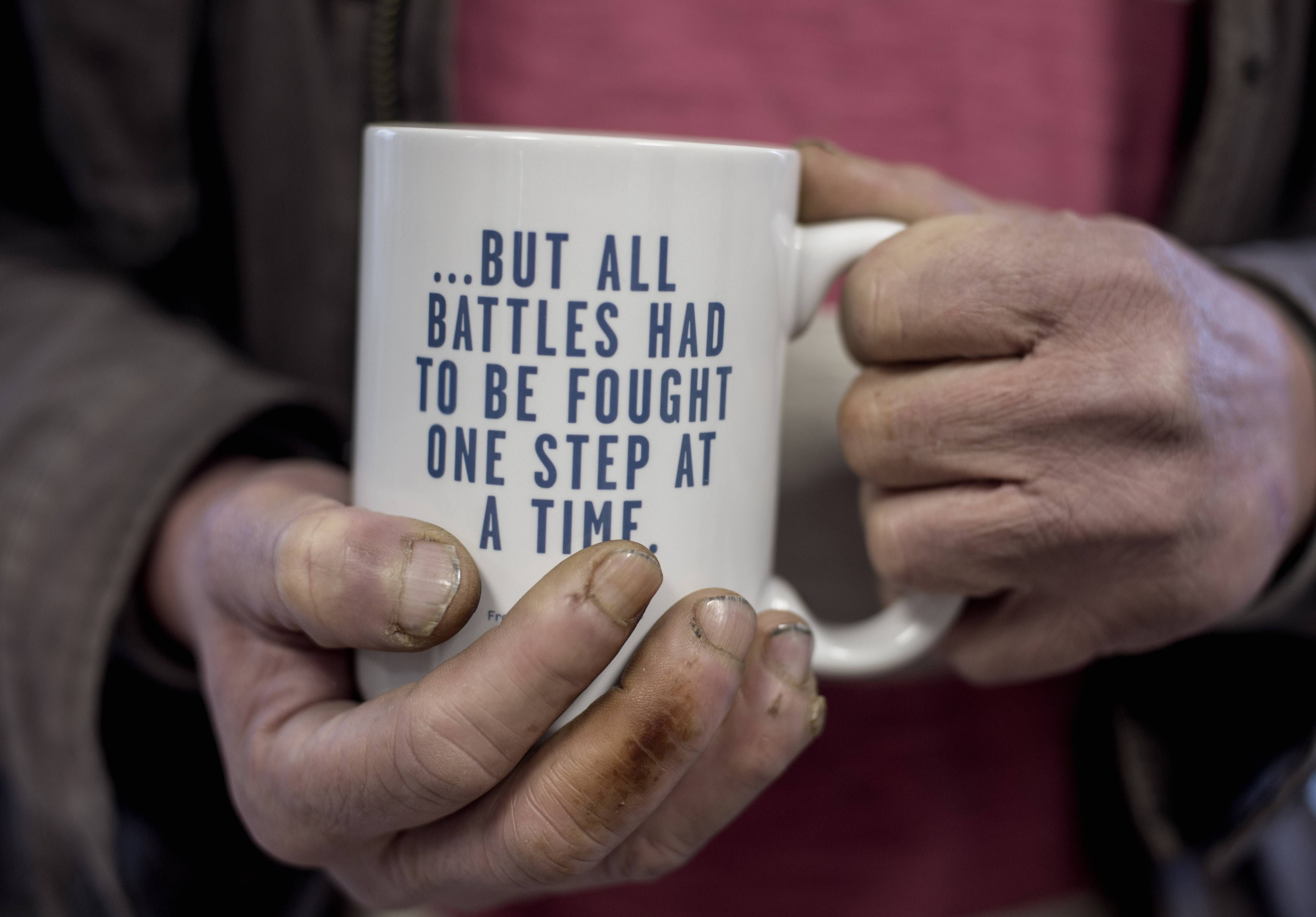 Hands holding a mug to support preventing homelessness campaign